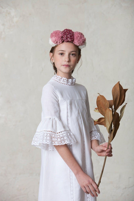 tocado para niña de ceremonia con pompones rosas y blancos